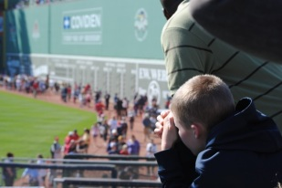 A young Red Sox fan observes Fenway Stadium during an open house to celebrate the ballpark's 100th anniversary.