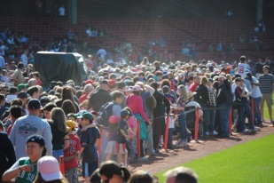 Red Sox fans form a line around the field during a Fenway Park open house to celebrate the ballpark's 100th anniversary.