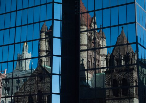 On Sunday September 29, the Trinity Church reflects off the John Hancock building in Copley Square. Created by Chelsea Diana.