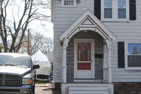 The house on Franklin Street where the younger Tsarnaev brother was found hiding in a covered boat similar to the new one that stands in the driveway. Photo by Chelsea Diana.